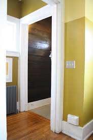 bright gold walls and dark brown shiplap behr s h 380 burnished