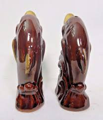 dolphin salt and pepper shakers ceramic set brown gold swimming in