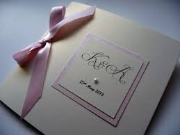 Folded Wedding Invitations Large Folded Wedding Invitation With A Plaque Detail And Bow On