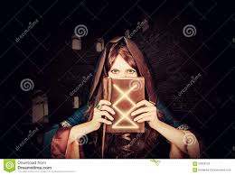 halloween photo book beautiful young halloween witch and old magic book stock photo