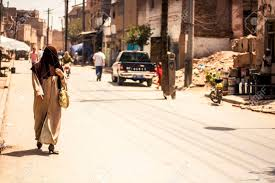 dusty china kashgar china 2 july 2009 muslim woman walking a dusty