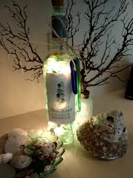 wine bottle christmas ideas painted wine bottle lighting ideas