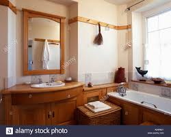 Wooden Vanity Units For Bathroom by Wooden Framed Mirror Above Basin Built Into Wooden Vanity Unit And