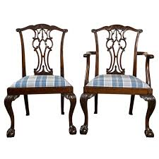 set of eight chippendale dining chairs with ball and claw feet at