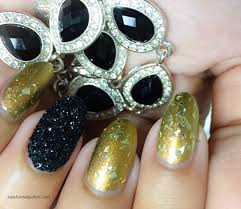 black glitter nail art accent design with shimmery olive green
