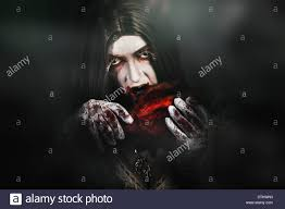 scary halloween portrait of a female horror vampire the