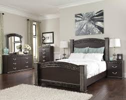 traditional queen poster bed with faux marble trim by signature