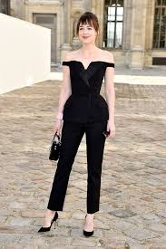 dakota johnson pubic hair dakota johnson looks like anastasia steele s opposite in this jumpsuit