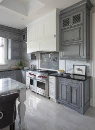 backsplash for black and white kitchen white and gray kitchen features gray wash cabinets paired with