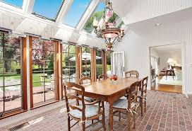 Country Dining Room With French Doors By The Corcoran Group - French country dining room