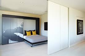 Sliding Bookcase Murphy Bed Pleasing Murphy Bed With Decorating Ideas Guest Room Wall Bookcase