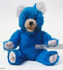 blue teddy with white ears and paws front view stock photo