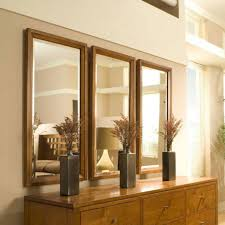 wall decor with mirrors make your room larger decorating with