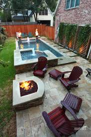 narrow pool with tub firepit perfect for our small backyard