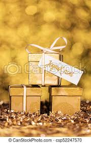 three golden gifts with text which means merry picture