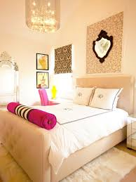 bedroom upholstered bed plus white bedding and pink bolsters with