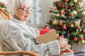 gifts for elderly grandmother charming elderly is resting at home with gift stock