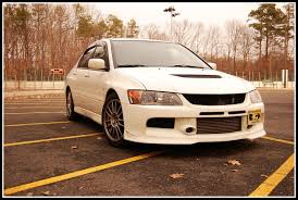 mitsubishi evo emblem want to remove my front mitsu badge on evo 9 help evolutionm