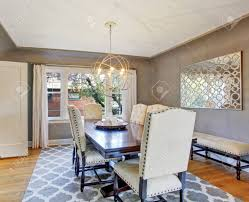 elegant dining room interior with wooden table and ivory suede