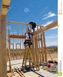 men building frame for house vertical royalty free stock