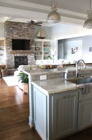best 20 kitchen open to living room ideas on pinterest half home of the month lake house reveal simple stylings kitchen island into living room painted cabinets stone fireplace