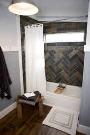manly bathroom herringbone tile wood floor beadboard in bathroom