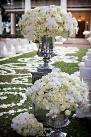 white flower arrangements ceremony décor photos white flower arrangement in silver urn