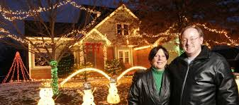 house with christmas lights to music lawrence couple s passion for christmas lights is off the charts