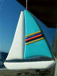 fused glass sail boat mounted on driftwood glass made by me