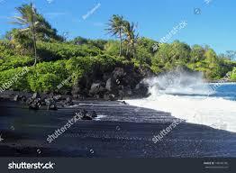 beaches with black sand black sand beach crashing surf palm stock photo 148705706