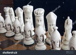 beautiful chess pieces on chess board stock photo 54086365