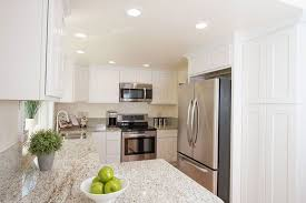 light granite countertops with white cabinets giallo ornamental granite countertops pictures cost pros and cons