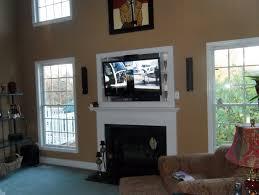 best 25 hide tv ideas only on pinterest tv above fireplace tv
