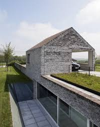Ultra Modern Houses Fort Like House Design Partially Submerged Twin Narrow Structures