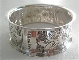 collect silver napkin rings chop to the neck