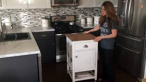 small kitchen island with cooktop crosley roots rack cart wood top