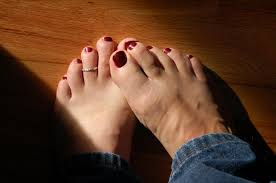 my male painted toes with a toe ring red polish and jeans men