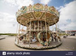 a traditional carousel or merry go at a seaside