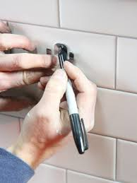 How To Get Marker Off The Wall by How To Install A Toilet Paper Holder How Tos Diy