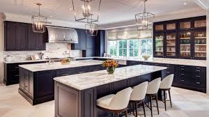 transitional kitchen with black cabinets white and gray marble