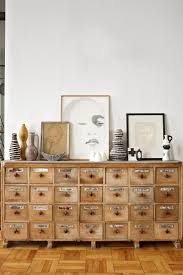 vintage home interior products drawer cabinet and gallery wall with neutral color palette home
