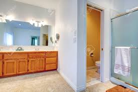 large white fiberglass tubs mixed black ceramic floor as well f spacious bathroom with cabinets and large mirror view of open