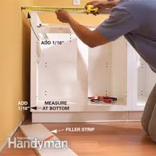 Install Kitchen Base Cabinets Installing Kitchen Cabinets Family Handyman