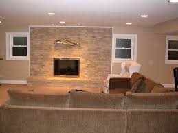 basement wall mount fireplace with stacked stone tile accent wall