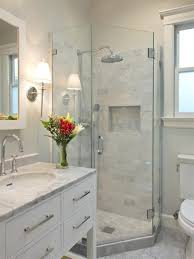 small bathroom with marble tiles and corner neo angle shower stall