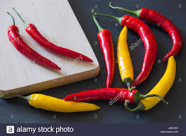 colorful paprika on a black stone table in the kitchen stock