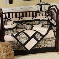interior black and beige animal printed black crib bedding on
