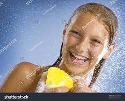 happy young taking shower bathing stock photo 82533460