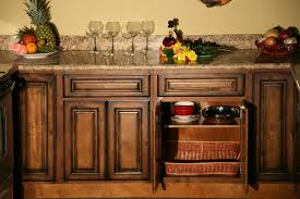 rustic kitchen cabinets feature natural edge cedar doors and