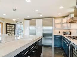 stainless steel appliances dark wood inset cabinet doors pendant